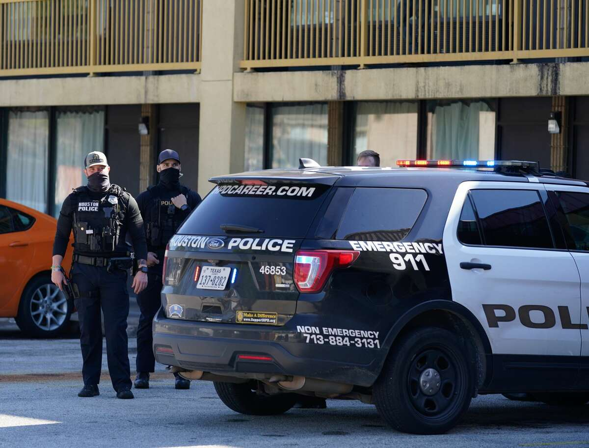 Police are shown at the scene of an officer involved shooting at the North Villa Inn, 16510 North Freeway, Tuesday, Jan. 5, 2021 in Houston.
