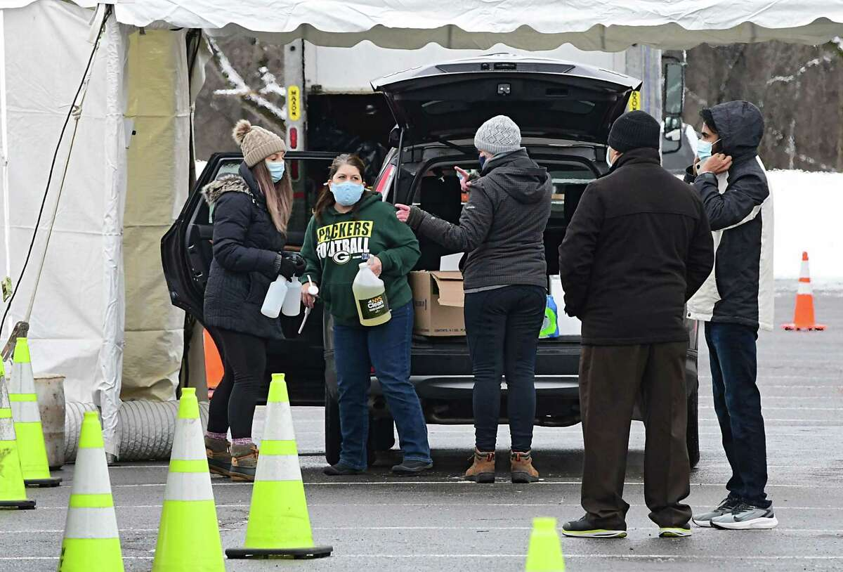 Workers set up a state testing site in Saratoga Spa State Park to provide COVID-19 testing for N. Fox jewelry customers on Monday, Jan. 4, 2021 in Saratoga Springs, N.Y. The first New York case of the U.K. coronavirus strain was detected in a man who works at the jewelry store on Broadway. (Lori Van Buren/Times Union)