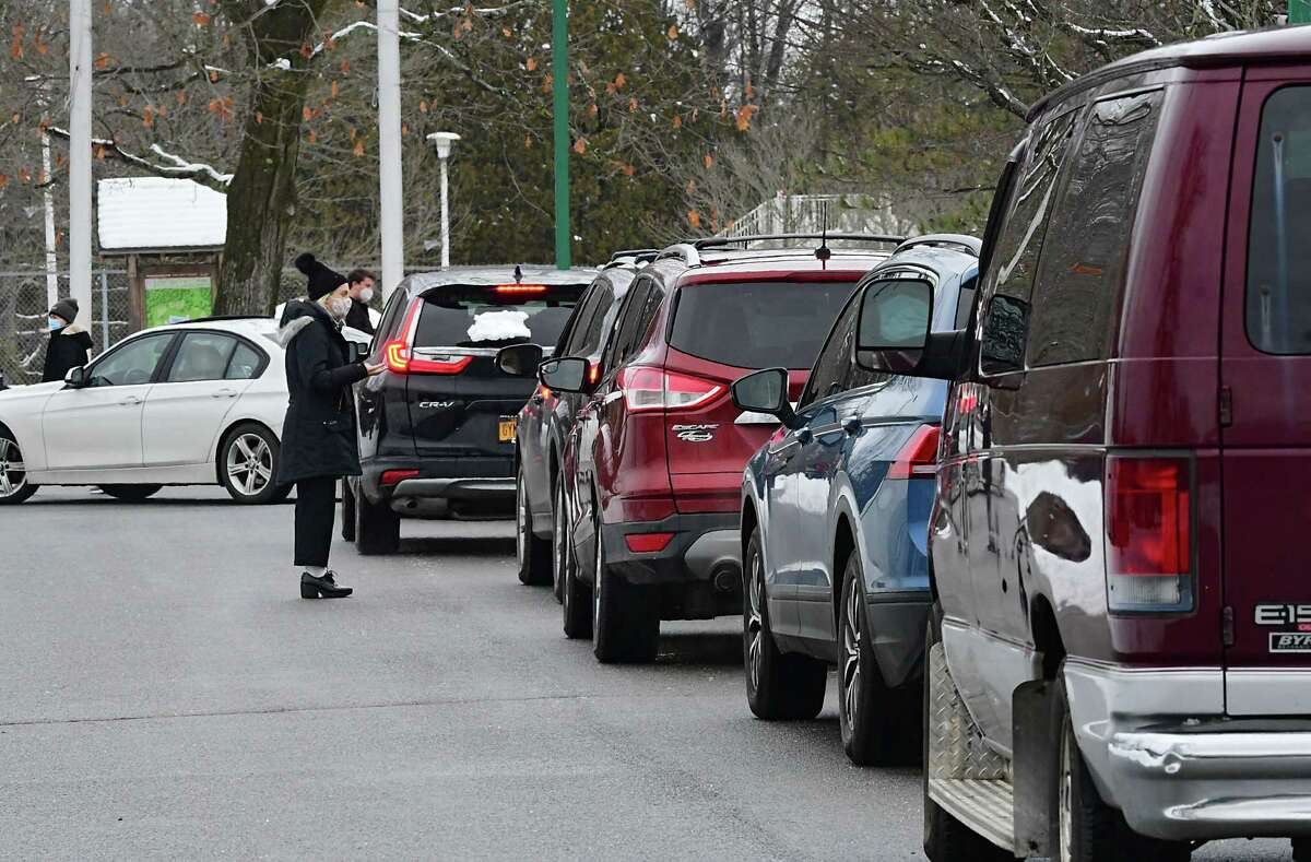 Cars are lined up at a state testing site in Saratoga Spa State Park to provide COVID-19 testing for N. Fox jewelry customers on Monday, Jan. 4, 2021 in Saratoga Springs, N.Y. The first New York case of the U.K. coronavirus strain was detected in a man who works at the jewelry store on Broadway. (Lori Van Buren/Times Union)