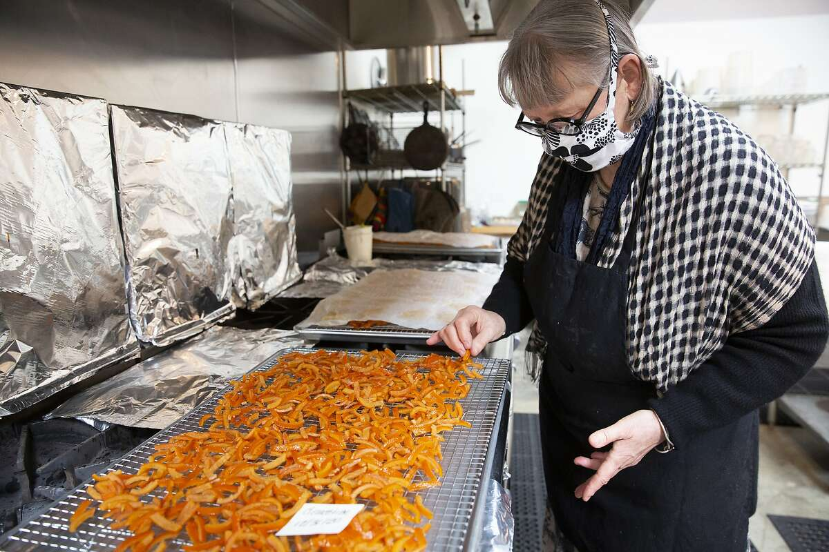 June Taylor looks over candied clementine peels at her kitchen in Berkeley, Calif. on Monday, January 4, 2021. After 17 years in her current space and over 30 years of preserving, June Taylor is going to be closing down her business and kitchen.