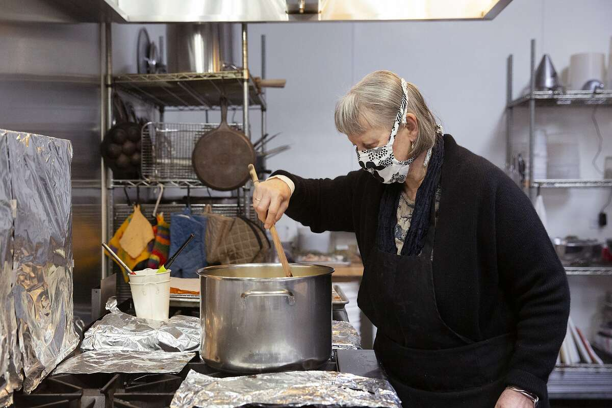 June Taylor stirs a pot of Meyer lemon skins that will be made into candy at her kitchen in Berkeley, Calif. on Monday, January 4, 2021. After 17 years in her current space and over 30 years of preserving, June Taylor is going to be closing down her business and kitchen.