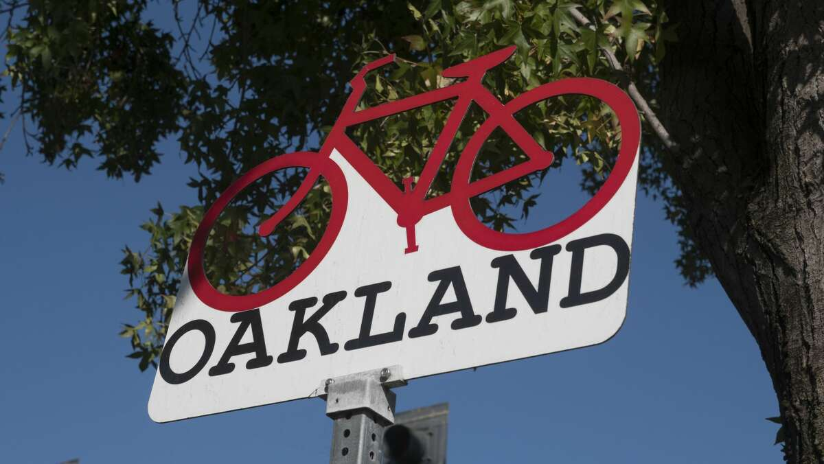 Oakland California sign with bicycle.