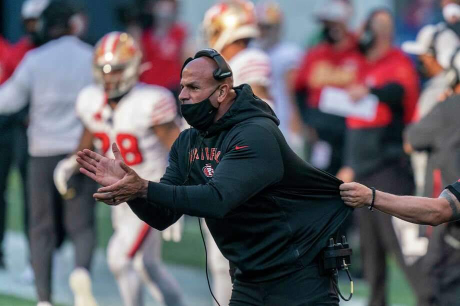 FILE - In this Nov. 1, 2020, file photo, San Francisco 49ers defensive coordinator Robert Saleh cheers on his team from the sideline during the first half of an NFL football game against the Seattle Seahawks in Seattle. One year ago, Saleh and Kansas City Chiefs offensive coordinator Eric Bieniemy missed out on the coaching carousel despite being coordinators of the two Super Bowl teams. The two figure to be near the top of many of the lists of possible head coaching candidates again this offseason when the NFL is hoping some new rules lead to more opportunities for minority coaches.(AP Photo/Stephen Brashear, File) / Copyright 2020 The Associated Press. All rights reserved.