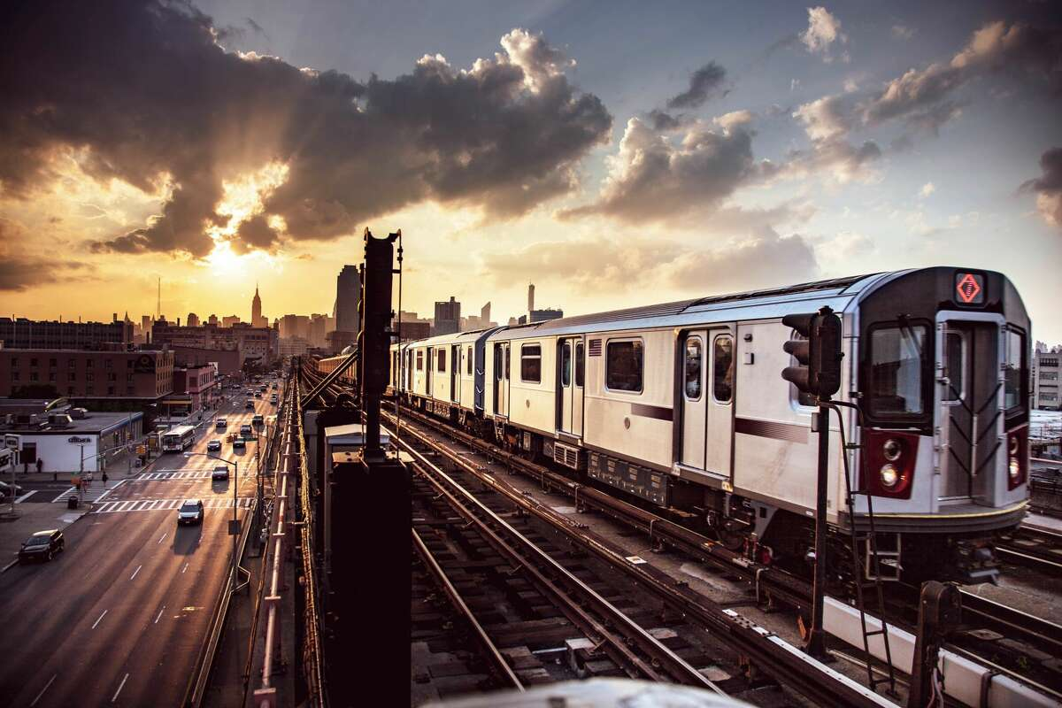Elevated subway train and New York City skyline.