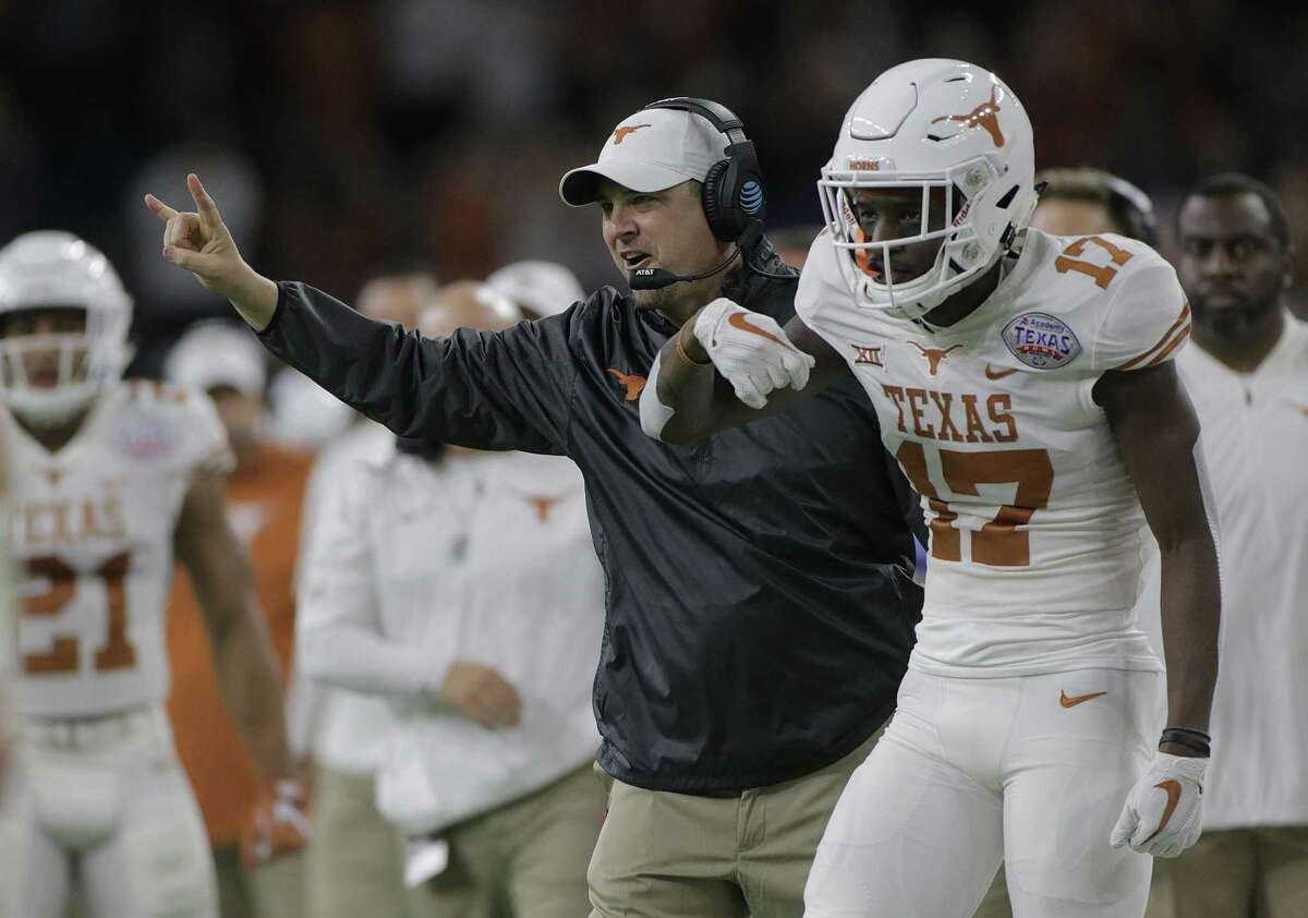 Texas Longhorns head coach Tom Herman celebrates after the team's first touchdown in the first quarter of the The Academy Sports + Outdoors Texas Bowl against Missouri at NRG Stadium on Wednesday, Dec. 27, 2017, in Houston. ( Elizabeth Conley / Houston Chronicle )