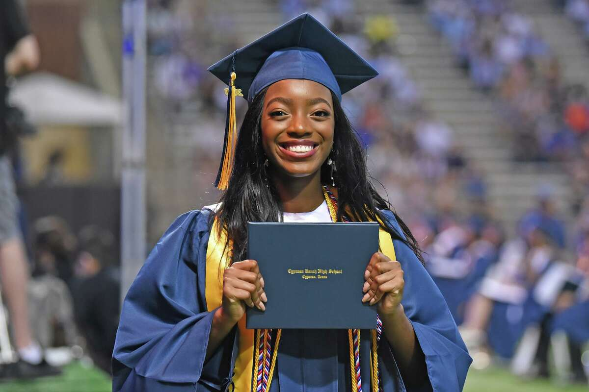 A Cy Ranch Class of 2020 grad poses with her diploma.