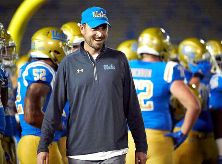 Edwardsville High School graduate Jimmy Dougherty accepted the passing game coordinator and quarterbacks coaching positions at the University of Arizona Monday. Dougherty is shown on the UCLA sidelines, where he spent the last four seasons as the Bruins' passing game coordinator and wide receivers coach. Photo: UCLA Athletics
