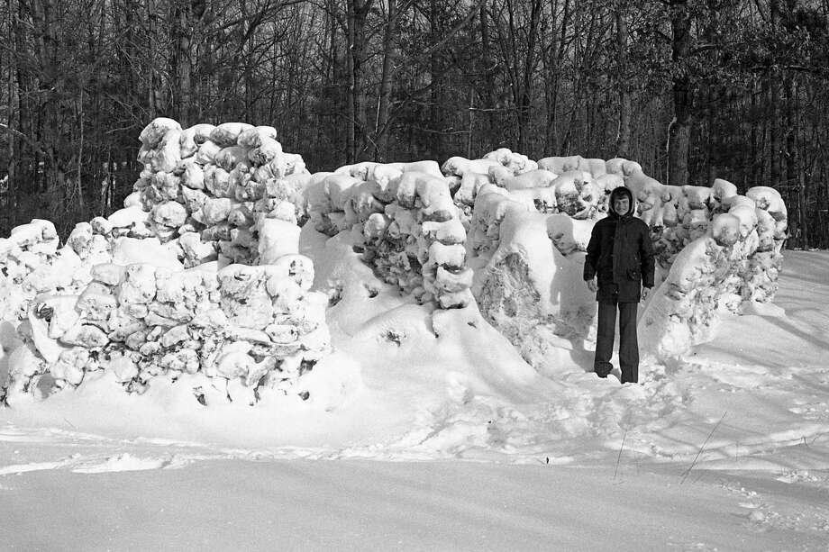 From the front page of the Manistee News Advocate on Jan. 6, 1981, 11-year-old Scott Mikolajczak, of Cherry Road, stands beside the snow fort he built in eight hours recently. The fort is guaranteed to stave off snowballs but lacks central heating. Scott is a sixth grader at Jefferson School. (Manistee County Historical Museum photo)