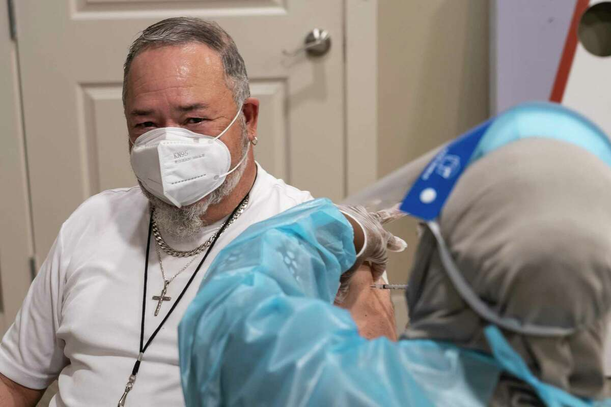 Robert Sprague of Avanti Senior Living receives his first dose of vaccine at CVS on Wednesday in Cypress.