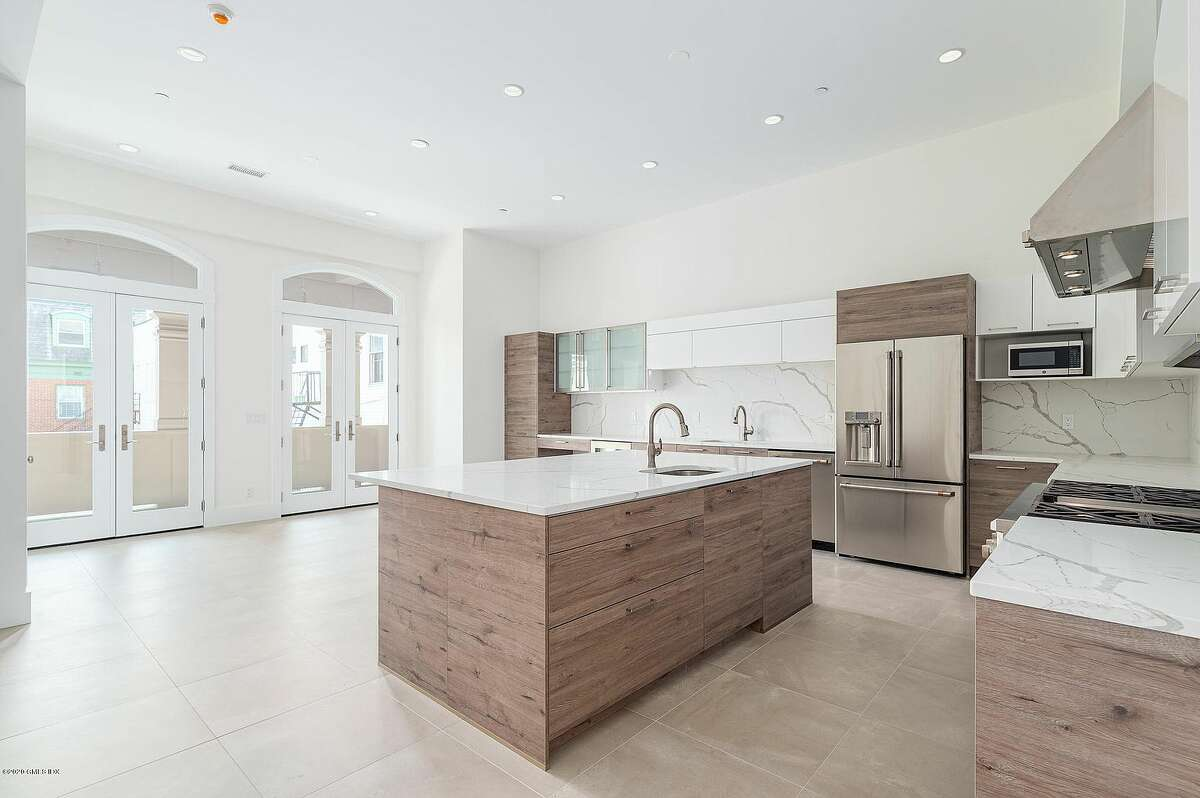 A unit at 121 Greenwich Ave. is listed for rent for $13,500 a month. Features include an open floor plan in the living/kitchen area, a soaking tub, walk-in closet and private elevator entrances.