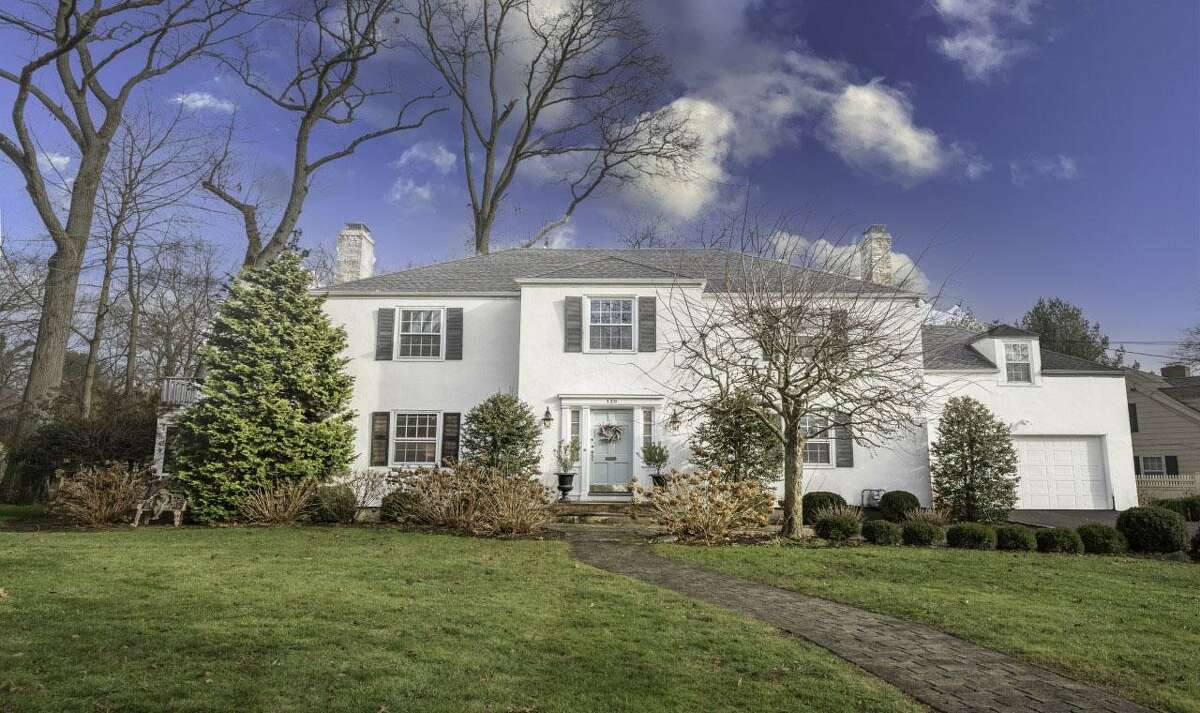 The stucco and masonry colonial house at 139 Northwood Road, Fairfield is in the Stratfield neighborhood.