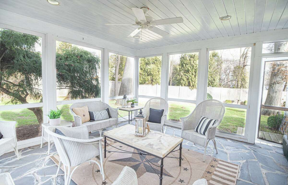 Enclosed screened porch at 139 Northwood Road, Fairfield.