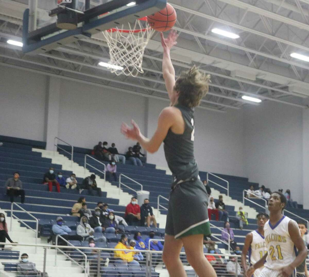Pasadena's Brock Fosnight scores one of his six buckets during the team's big road win at Channelview a week ago. Fosnight, who also had a pretty slam dunk in the game, needs a big night against a rugged Dobie squad.