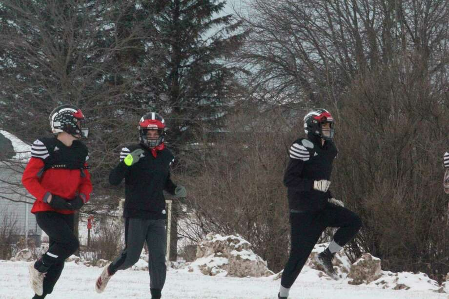 Reed City football players last week practiced in the snow to get ready for Saturday's regional title game. (Pioneer photo/John Raffel)