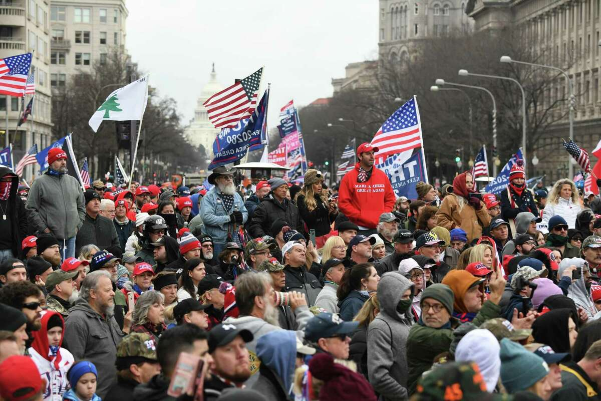 Supporters of President Donald Trump hold a rally as they protest the upcoming electoral college certification of Joe Biden as president in Washington, D.C., on Tuesday.