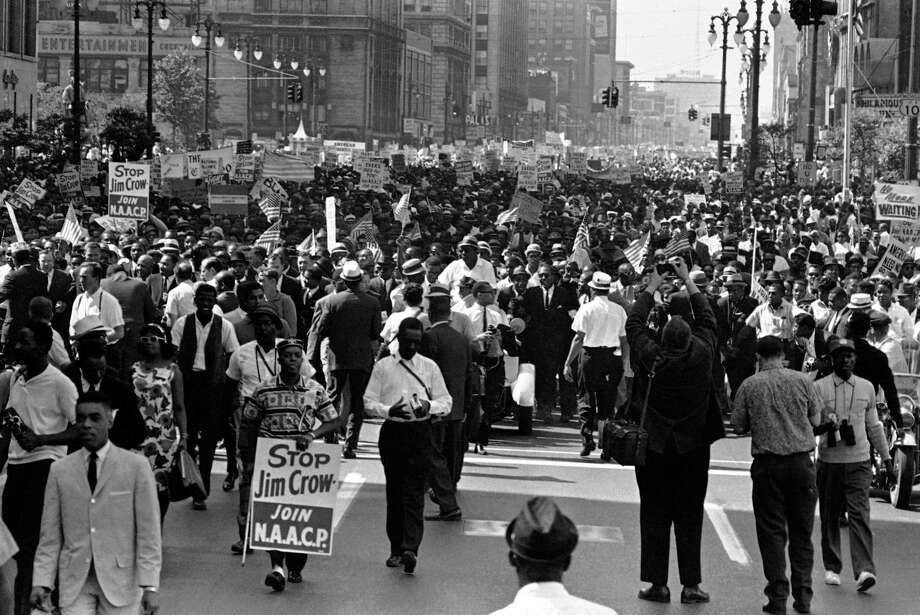 Thousands of Freedom Marchers engulf Woodward Ave., in downtown Detroit, June 23, 1963. The parade, billed as a protest against racial discrimination, was led by Rev. Martin Luther King, Jr., civil rights leader. (AP Photo) / 1963 AP