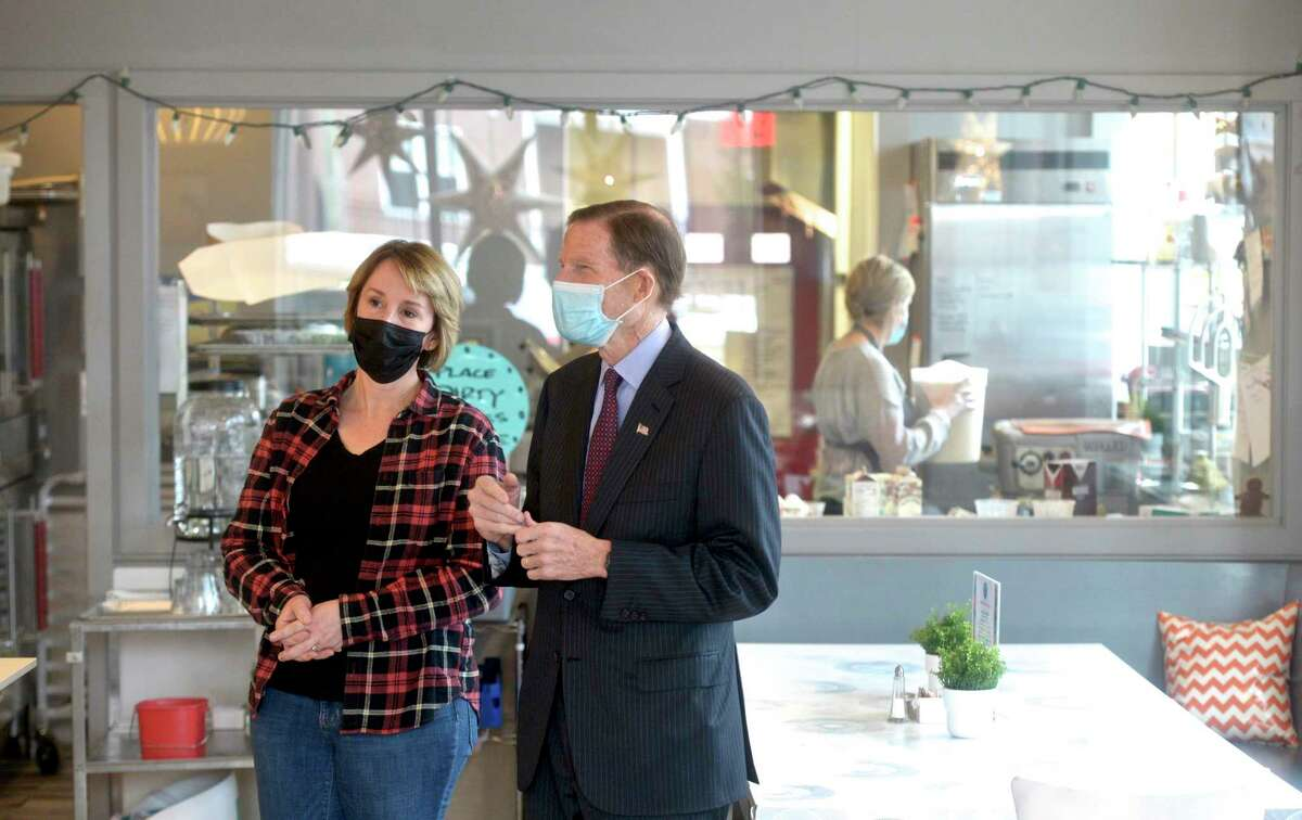 U.S. Sen. Richard Blumenthal, right, talks with Anna Llanos, owner of Mothership on Main, on Tuesday morning. Blumenthal was there to talk with Llanos about her small business and the Paycheck Protection Program. Baker Gillian Cuddy works behind them. January 5, 20201, in Danbury, Conn.