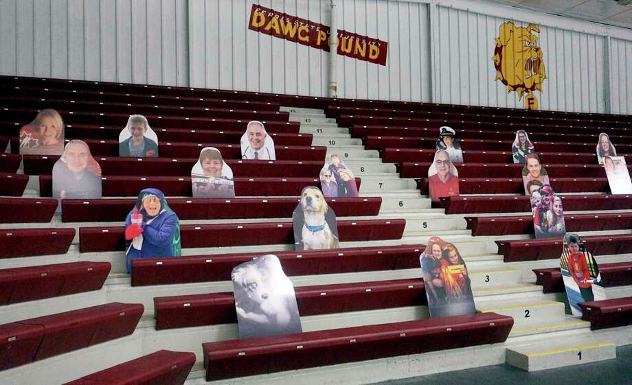 Cardboard cut-outs of Bulldog supporters will be a common sight for months to come at Ferris State hockey and basketball games. (Pioneer photo/Joe Judd)