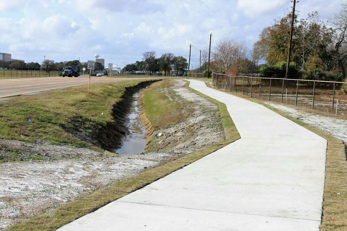 The hike-and-bike trail at the intersection of Space Center Boulevard and NASA Road 1 has been replaced with an 8-foot wide concrete path as part of an effort to upgrade and extend the Harris County Precinct 2 trail system.