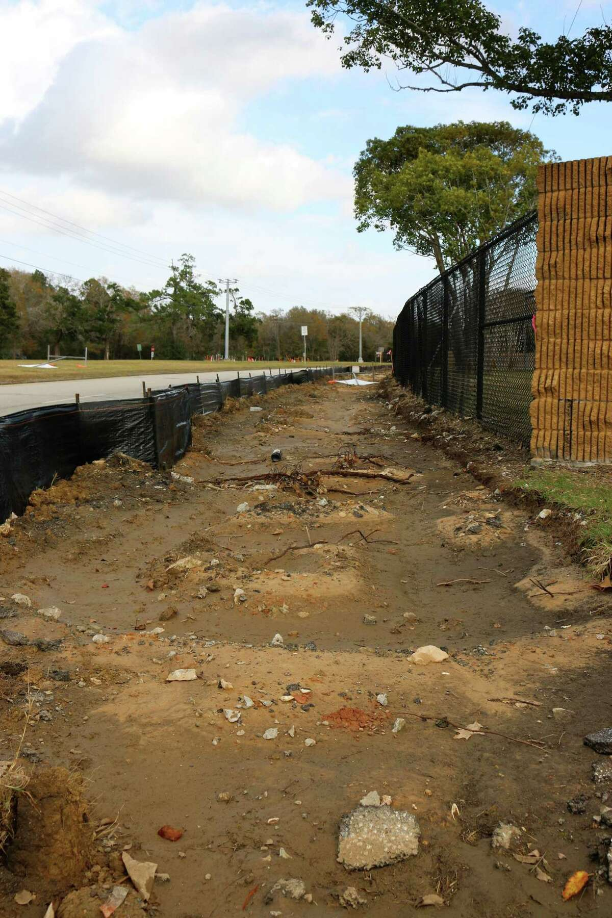 The asphalt hike and bike trail along Bay Area Boulevard near Armand Bayou has been removed and will be replaced by a wider concrete path.