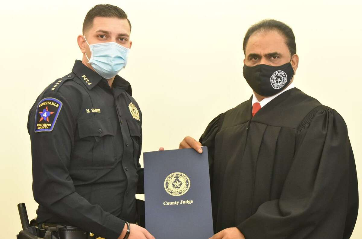 Fort Bend Precinct 4 Constable Nabil Shike, left, was recently sworn into service by Fort Bend County Judge KP George.