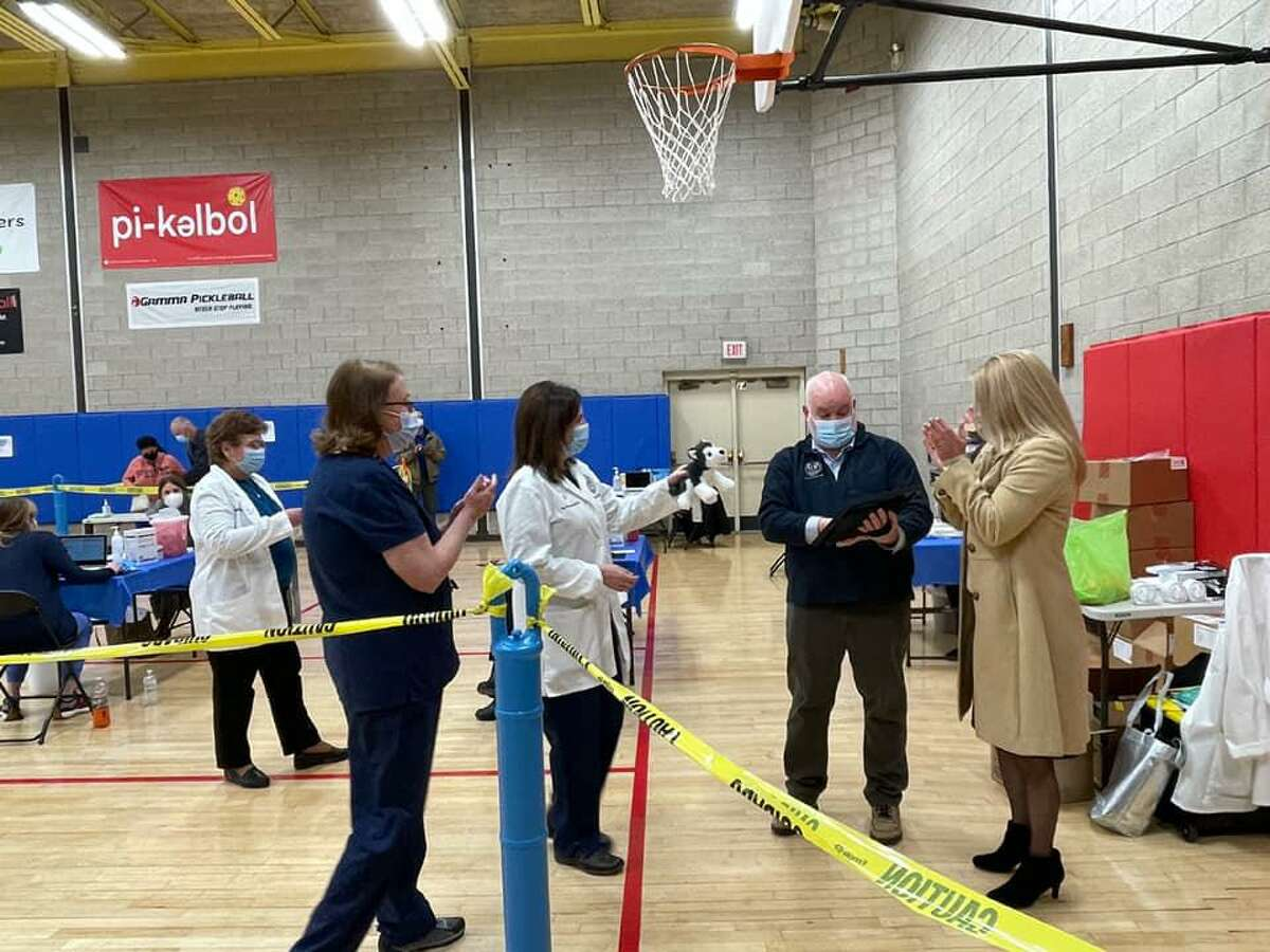 First Selectwoman Brenda Kupchick, Health Department Director Sands Cleary and health department staff at a vaccination clinic on Dec. 30.