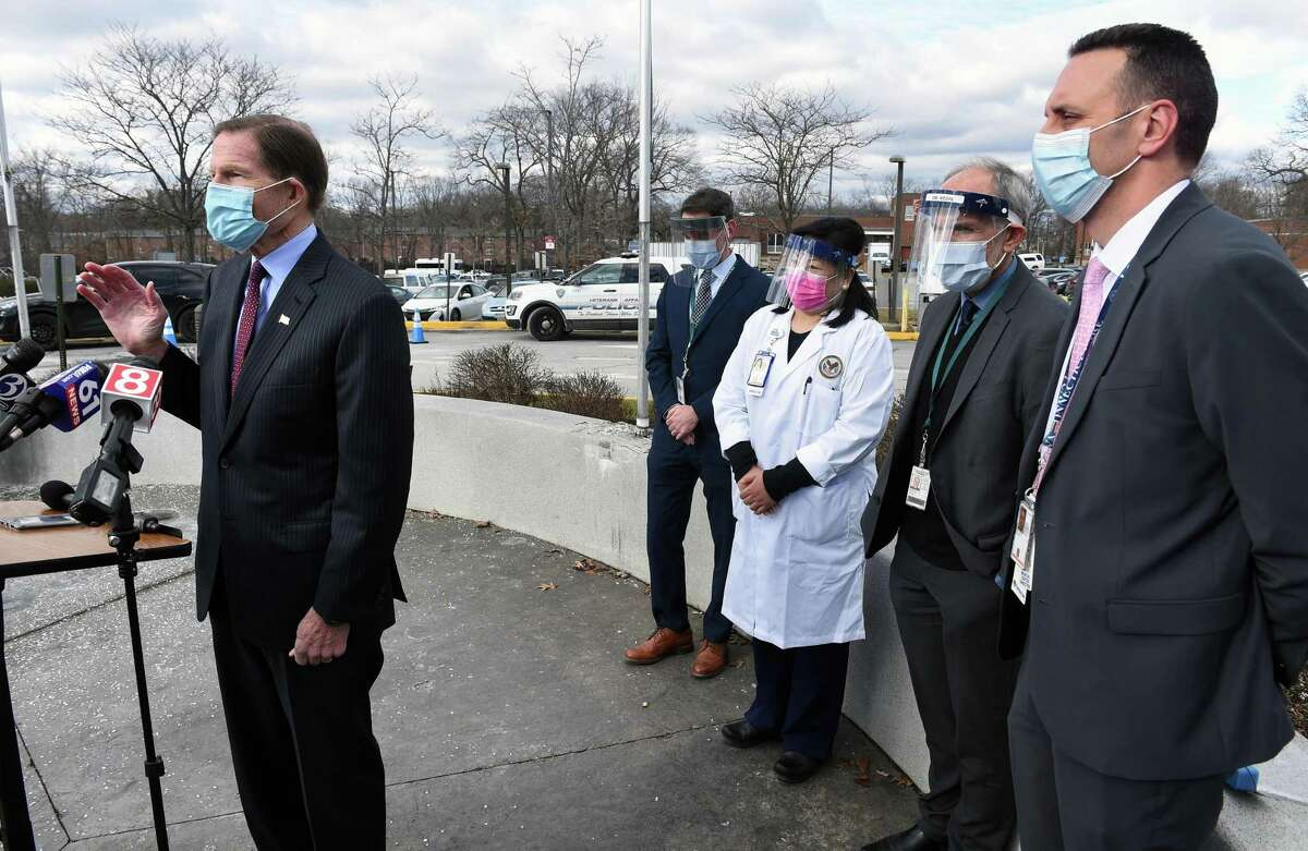 U.S. Sen. Richard Blumenthal, left, speaks at a press conference announcing the start of COVID-19 vaccinations for veterans at the Veteran's Affairs medical center in West Haven Jan. 5, 2021. At right is VA Connecticut Healthcare Director Alfred Montoya Jr.