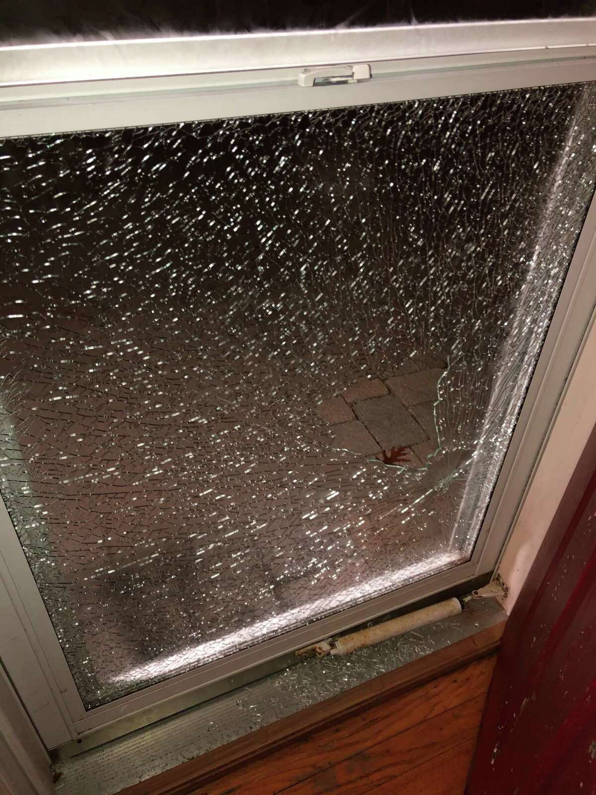 A resident posted a photo of a broken window to the Neighbors app from Ring, reporting that it was a possible drive-by shooting. Police say the window was shot by a pellet gun. The department says it doesn't consider reports on social media and apps official.