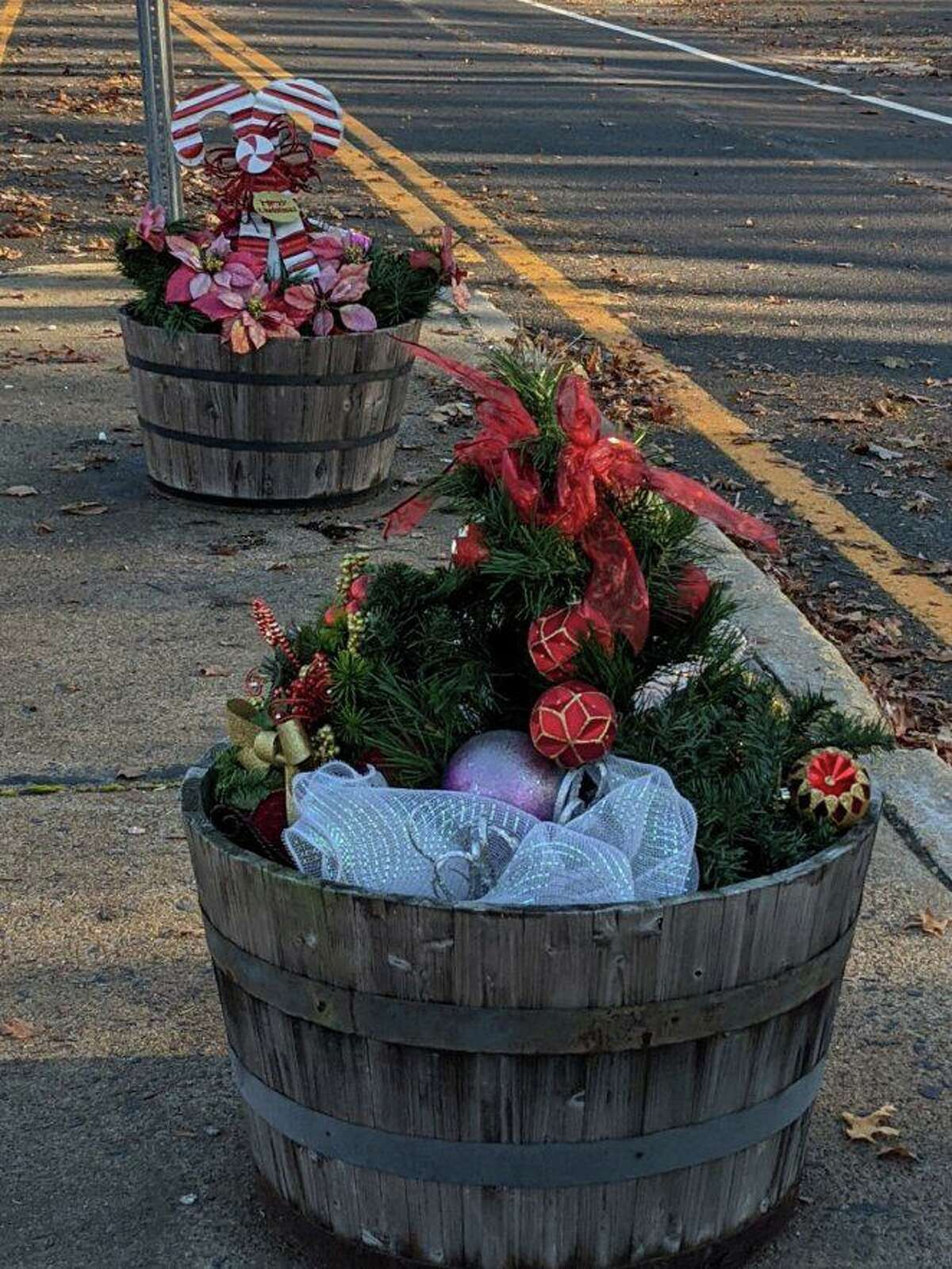 Members of the North Haven Garden Club provided holiday decorations in barrels and pots around town.