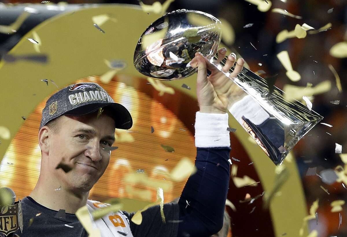 FILE - In this Feb. 7, 2016, file photo, Denver Broncos quarterback Peyton Manning holds up the Vince Lombardi Trophy after the Broncos defeated the Carolina Panthers 24-10 in NFL football's Super Bowl 50 in Santa Clara, Calif. Manning, in his first-year of eligibility, was selected as a finalist for the Pro Football Hall of Fame's class of 2021 on Tuesday, Jan. 5, 2021. (AP Photo/Julie Jacobson, File)