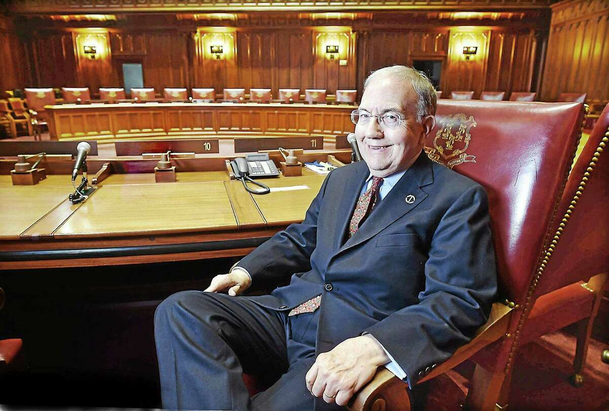 (Catherine Avalone - New Haven Register) ¬ Sen. Martin Looney, D-11, of New Haven, photographed in the Senate chamber at the Capitol in Hartford Tuesday, December 23, 2014, is currently the Democratic Senate majority leader, but will be theSenate president in January, replacing state Sen. Donald Williams, D-Brooklyn, who did not seek re-election.