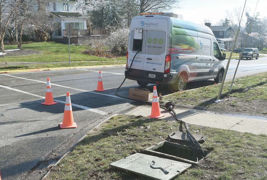 Crews with i3 Broadband install fiber optics Tuesday along Woodland Place in Jacksonville. The entire Jacksonville area should have i3 Broadband service by the end of the year. Photo: Rochelle Eiselt | Journal-Courier
