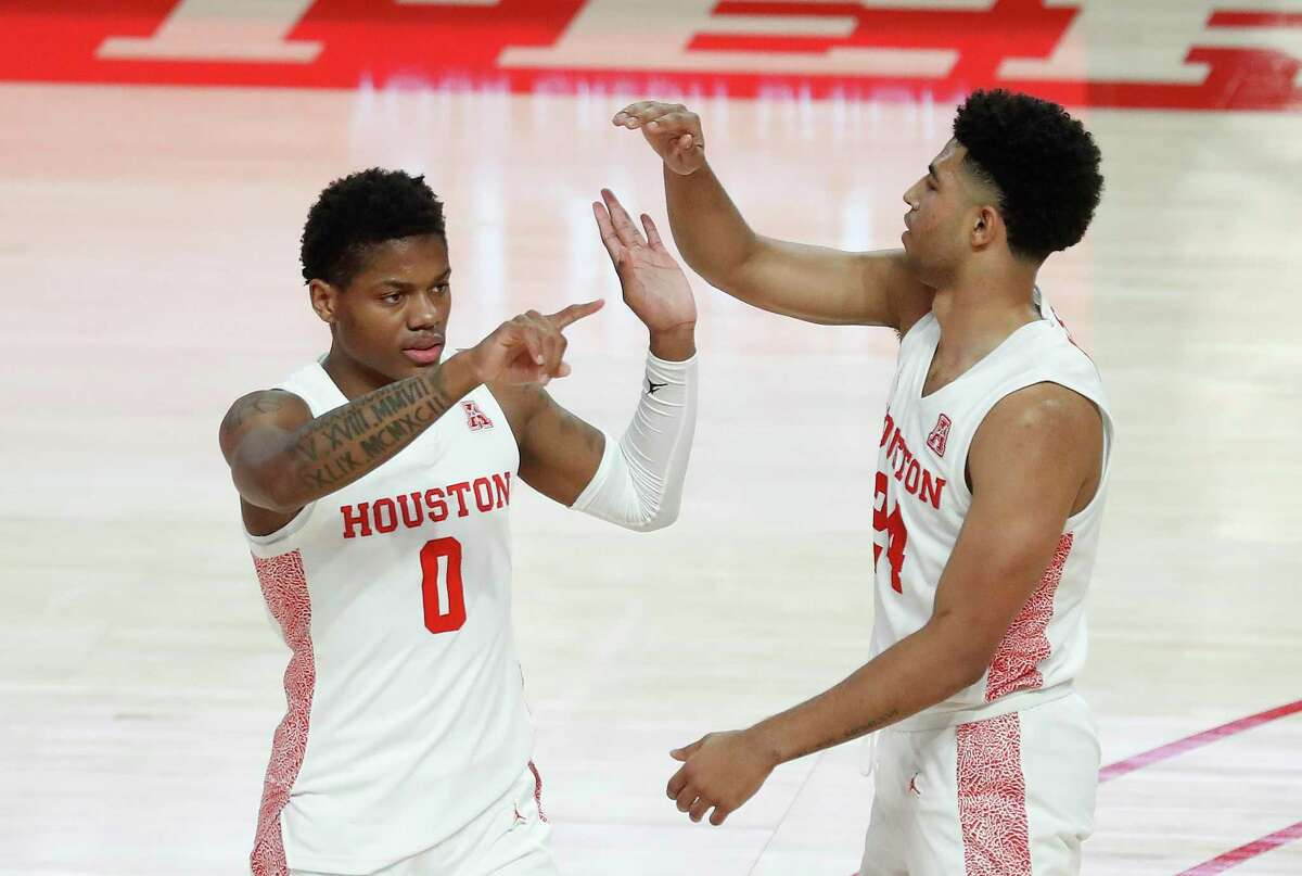Marcus Sasser (0) and Quentin Grimes are among the UH guards who will have to pick up the slack created by the departure of AAC preseason player of the year Caleb Mills.
