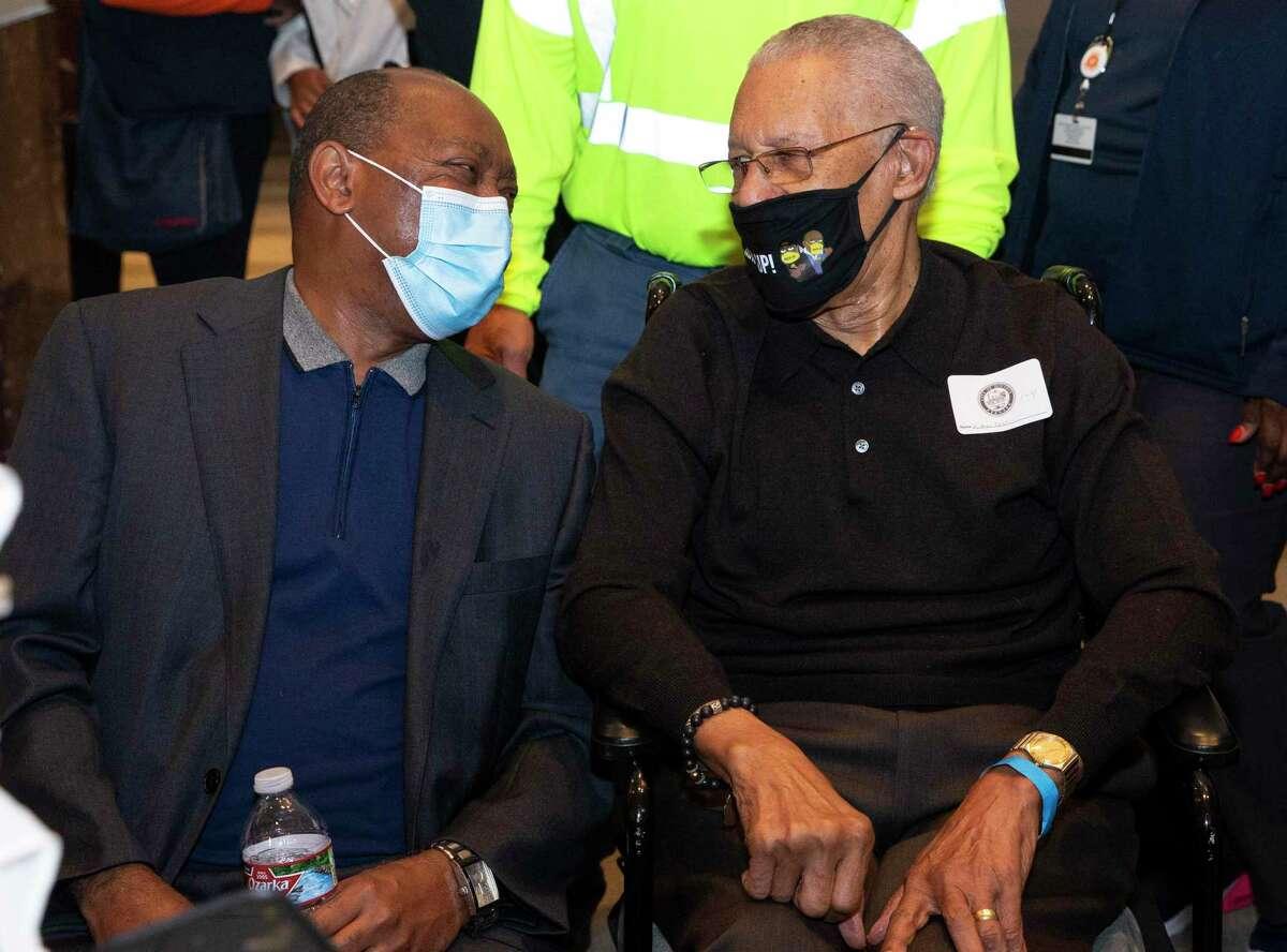 Houston Mayor Sylvester Turner talks to Rev. William
