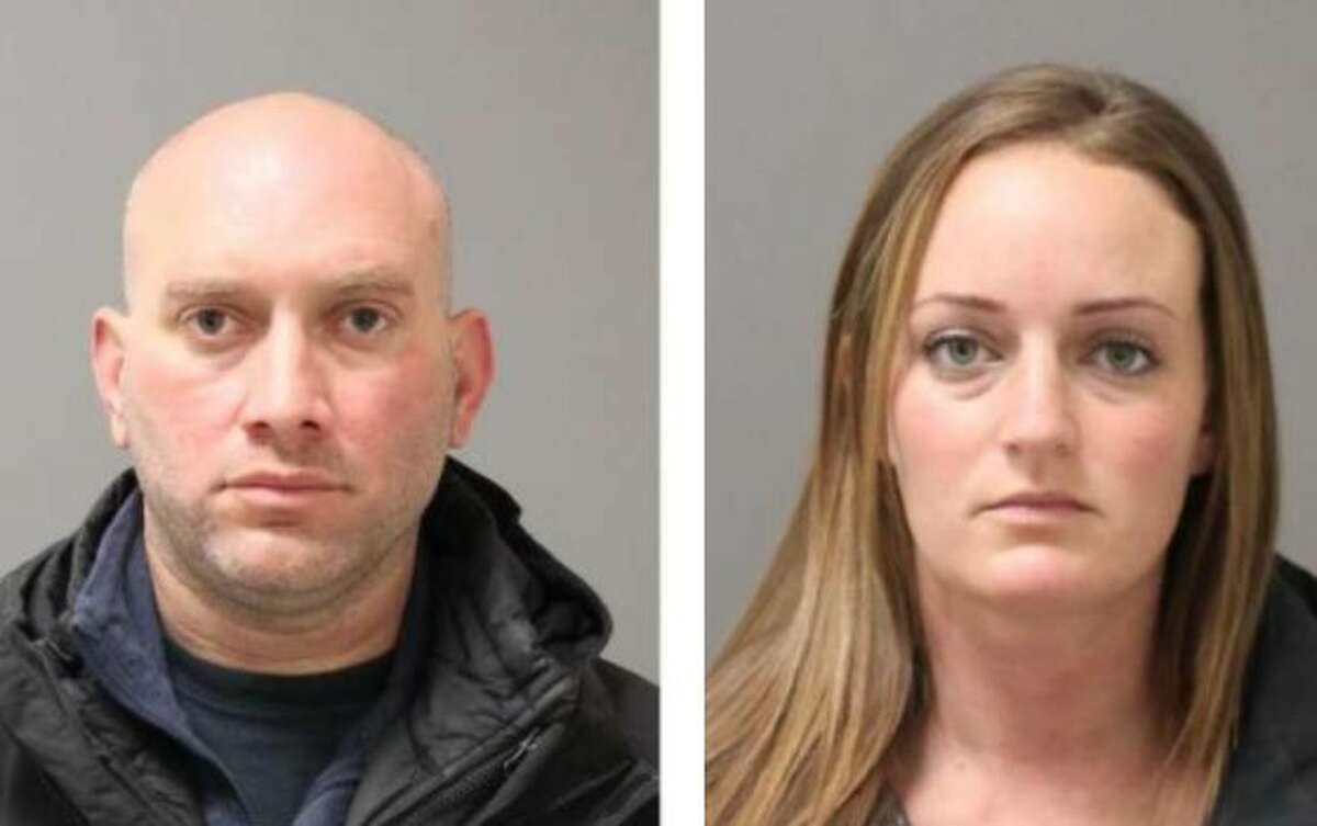 Norwalk police officers Michael DiMeglio and Sara Laudano turned themselves in Tuesday on charges of second-degree larceny and second-degree reckless endangerment.