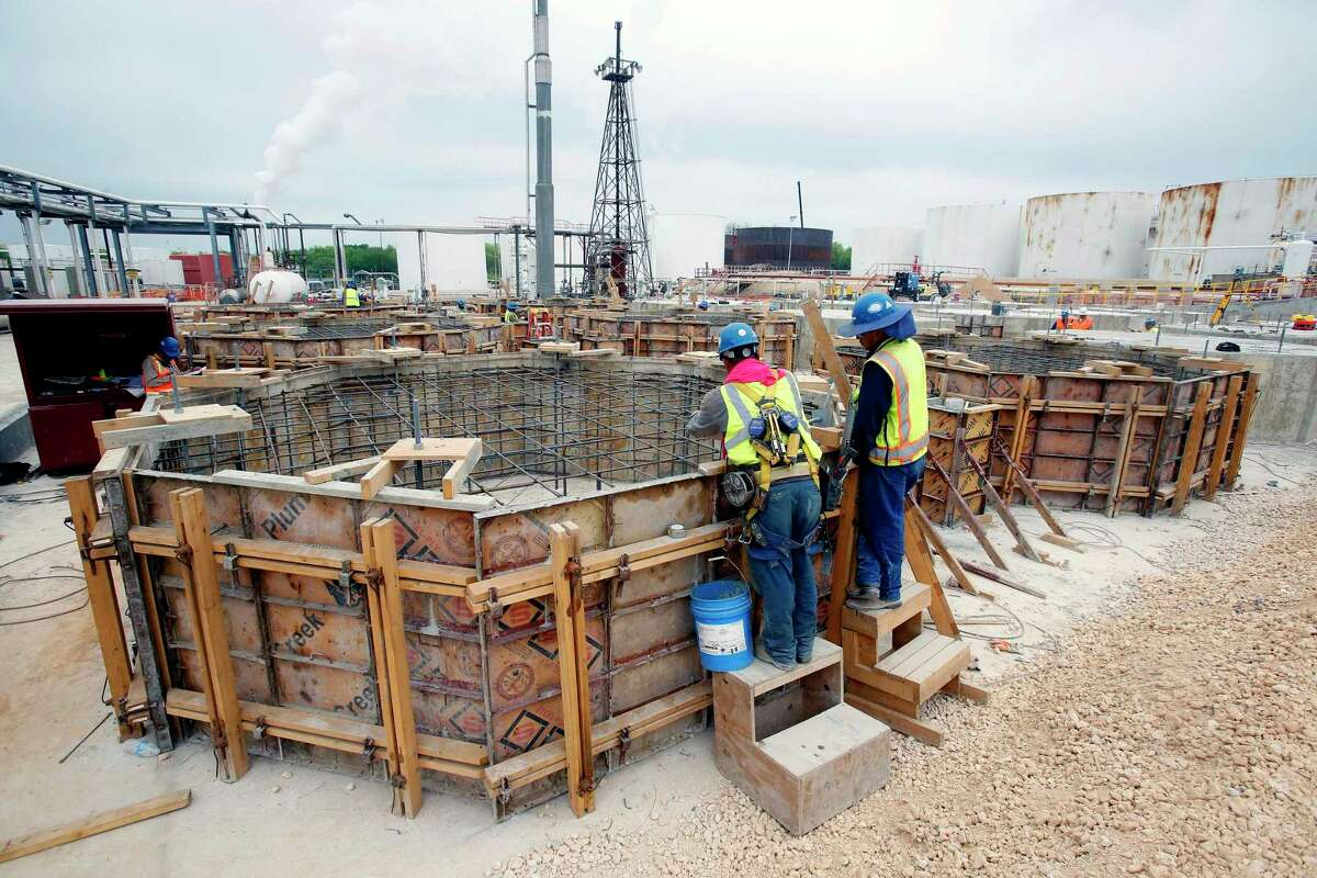 Workers check the frames at Calumet Specialty Products Partners' refinery on South Presa St. Thursday morning April 2, 2015.