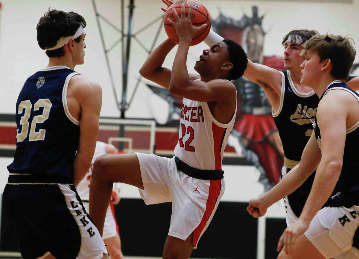 Porter power forward Colby Christian (32) gos up for a shot during the first quarter of a District 20-5A high school basketball game at Porter High School, Tuesday, Jan. 5, 2021.