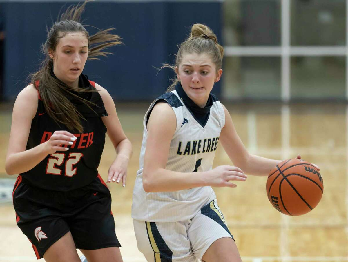 Lake Creek's Makenzie Logeman (1) drives the ball down the court while pressured from Porter's Katherine Spreyer (22) during the fourth quarter of a District 20-5A girls basketball game at Lake Creek High School, Tuesday, Jan. 5, 2021, in Montgomery.