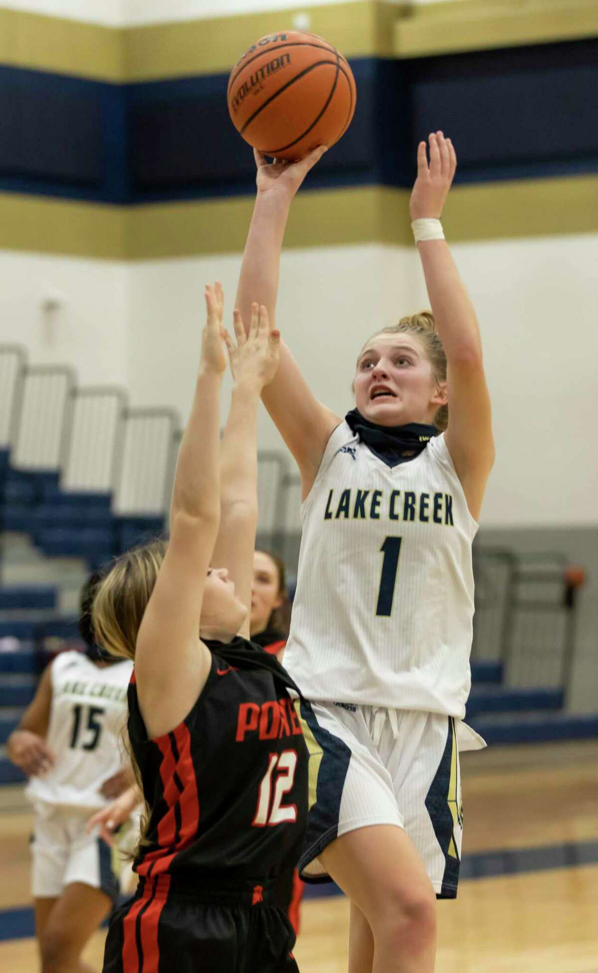 Lake Creek's Makenzie Logeman (1) catches a pass from the sideline while under pressure from Porter's Allie Seybert (12) during the first quarter of a District 20-5A girls basketball game at Lake Creek High School, Tuesday, Jan. 5, 2021, in Montgomery.