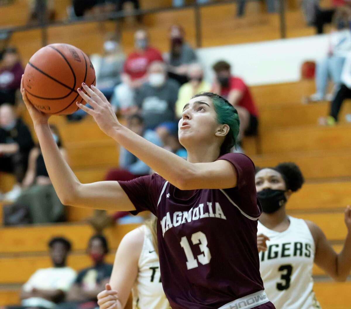 In this file photo, Magnolia forward Gabrielle Huetter (13) shoots for the basket during the first quarter of a non-district game in Porter Gym at Conroe High School, Tuesday, Dec. 29, 2020, in Conroe.