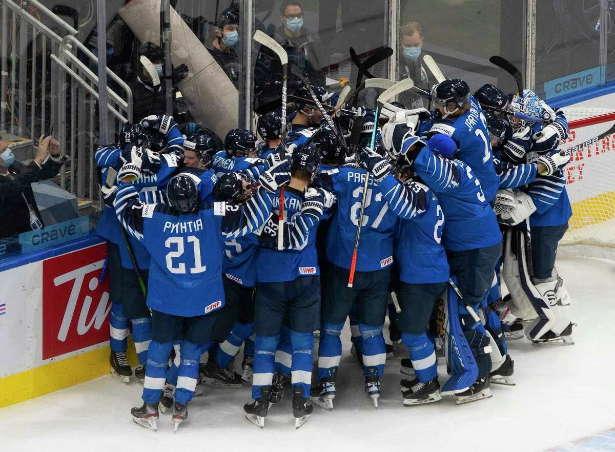 Finland celebrates a win over Russia in the third-place game in the IIHF World Junior Hockey Championship, Tuesday, Jan. 5, 2021, in Edmonton, Alberta. (Jason Franson/The Canadian Press via AP)