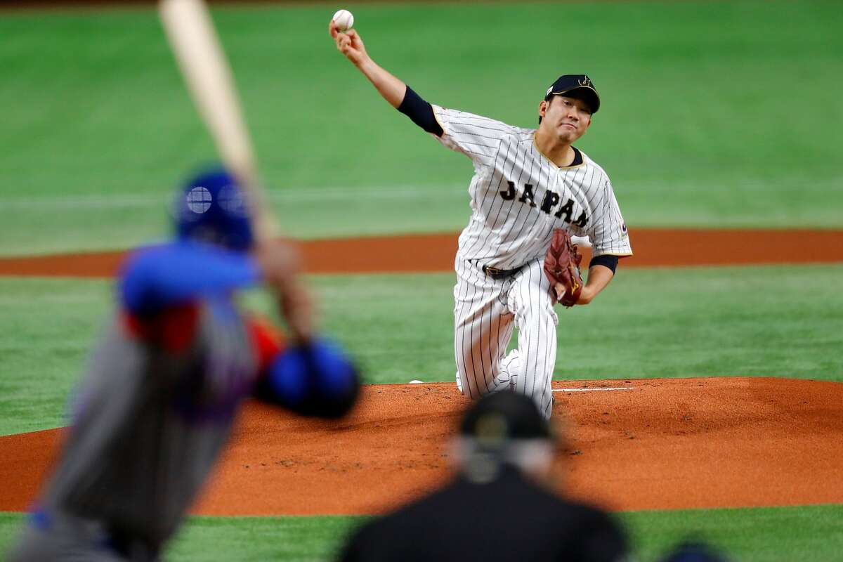 Tomoyuki Sugano delivers a pitch for Japan in the 2017 World Baseball Classic.