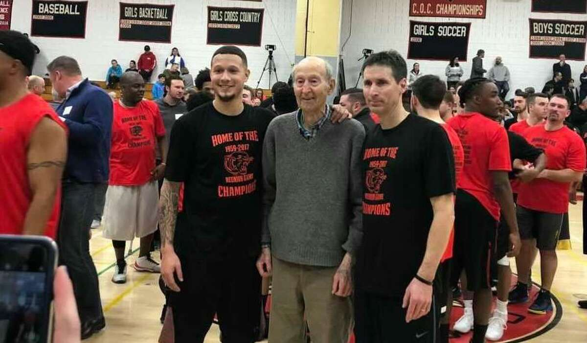 Former longtime Cromwell boys basketball coach Jake Salafia, center, is flanked by son Steve and grandson Isaiah, both of whom played for Cromwell. Jake Salafia died Jan. 5. He was 92.
