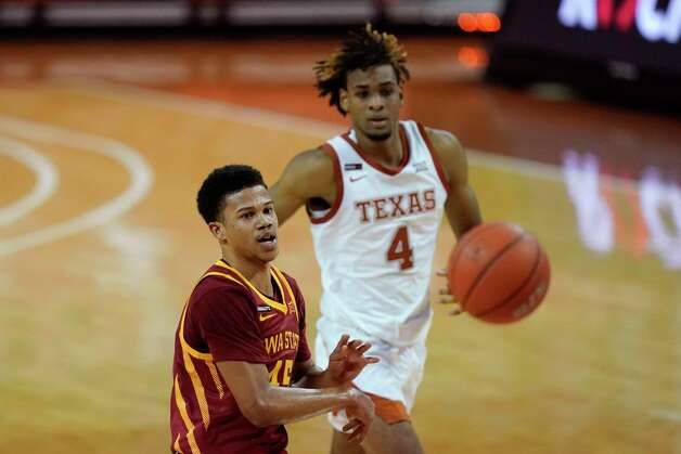 Iowa State guard Rasir Bolton passes ahead of Texas forward Greg Brown (4) during the second half of an NCAA college basketball game, Tuesday, Jan. 5, 2021, in Austin, Texas. (AP Photo/Eric Gay) Photo: Eric Gay, Associated Press / Copyright 2021 The Associated Press. All rights reserved.