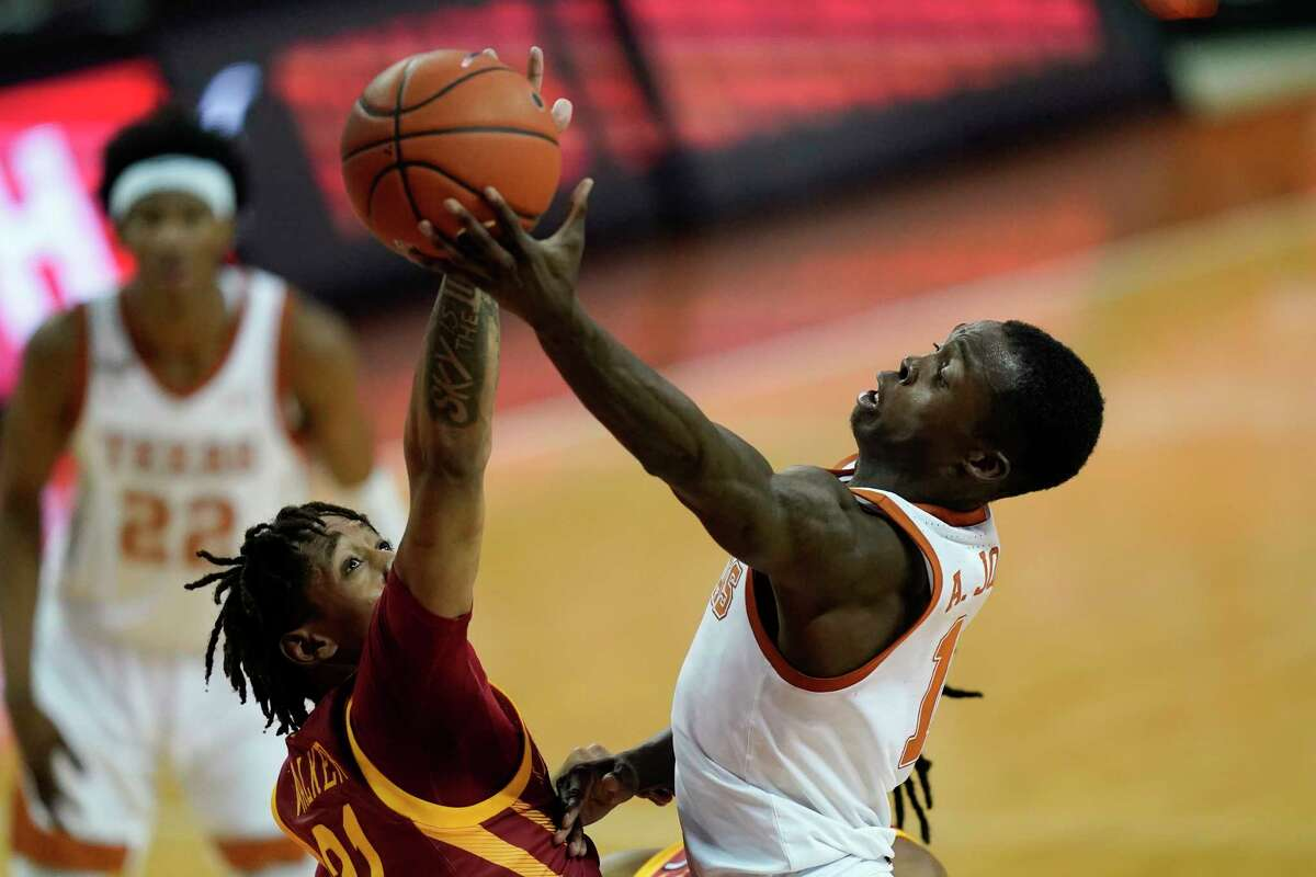 Texas guard Andrew Jones drives to the basket over Iowa State guard Jaden Walker, left, during the second half of an NCAA college basketball game, Tuesday, Jan. 5, 2021, in Austin, Texas. (AP Photo/Eric Gay)
