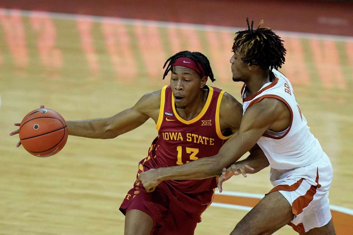 Iowa State forward Javan Johnson is fouled by Texas forward Greg Brown, right, during the second half of an NCAA college basketball game, Tuesday, Jan. 5, 2021, in Austin, Texas. (AP Photo/Eric Gay)