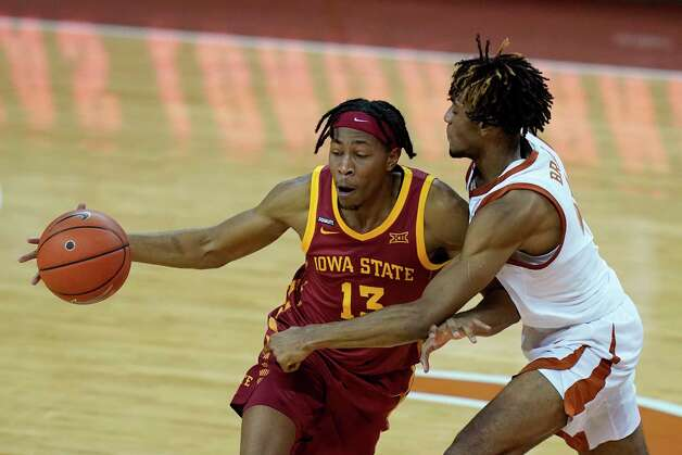 Iowa State forward Javan Johnson is fouled by Texas forward Greg Brown, right, during the second half of an NCAA college basketball game, Tuesday, Jan. 5, 2021, in Austin, Texas. (AP Photo/Eric Gay) Photo: Eric Gay, Associated Press / Copyright 2021 The Associated Press. All rights reserved.