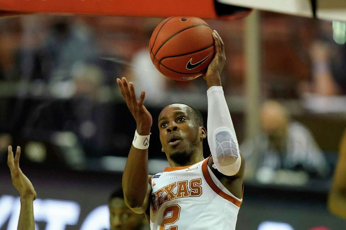Texas guard Matt Coleman III drives to the basket during the first half Tuesday. Coleman scored 13 points.