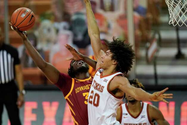 Iowa State forward Solomon Young shoots over Texas forward Jericho Sims (20) during the second half of an NCAA college basketball game, Tuesday, Jan. 5, 2021, in Austin, Texas. (AP Photo/Eric Gay) Photo: Eric Gay, Associated Press / Copyright 2021 The Associated Press. All rights reserved.
