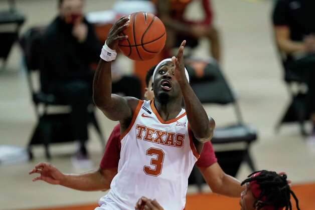Texas guard Courtney Ramey drives to the basket during the first half of an NCAA college basketball game against Iowa State, Tuesday, Jan. 5, 2021, in Austin, Texas. (AP Photo/Eric Gay) Photo: Eric Gay, Associated Press / Copyright 2021 The Associated Press. All rights reserved.